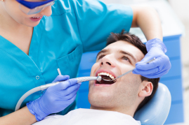 A picture of a man getting emergency dental care