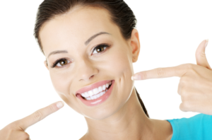 A picture of one of our urgent care dentists smiling for our patients to see