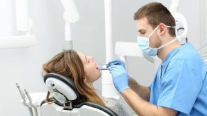 dentist performing a cleaning procedure photo