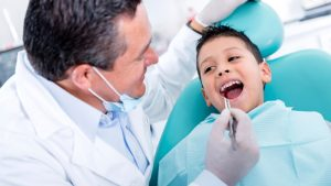 photo of a boy dental patient with dentist