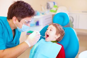 photo of a licensed dentist with boy patient