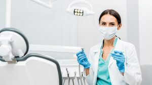 picture of a dentist beside dental chair